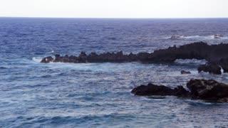 A lava sea arch on the island of Maui, Hawaii