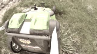 A lawn mower mowing tall grass in the lawn dreamy