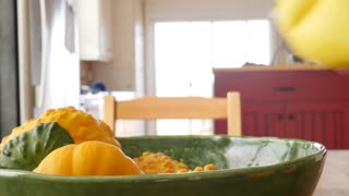 A man arranges pumkin gourds for decoration