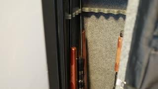 a man closes a gun safe