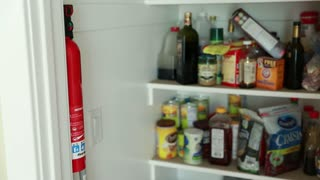 a man removes fire extinguisher
