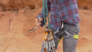 A man rock climbing in Moab in Southern Utah