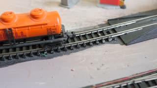 A Man Sets Replica Model Trains Onto The Track