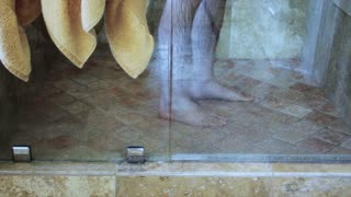 A man takes a shower in a luxurious shower
