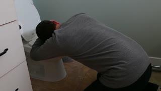 a man vomites into toilet