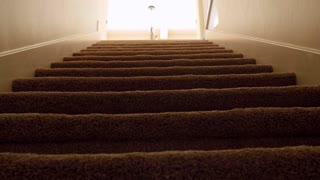 A man walks down house basement stairs