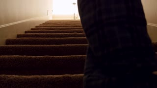 A man walks up house basement stairs
