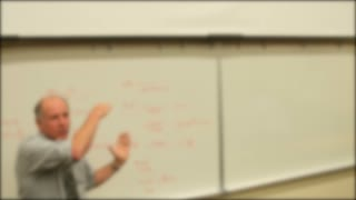 A math professor teaching in university classroom