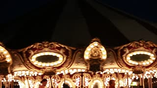 a merry go round at night time with lights