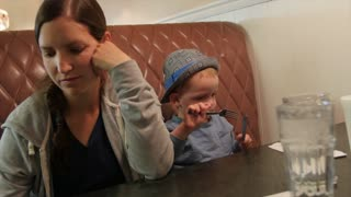 A mother and toddler at diner