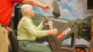 A Physical Therapist Helps An Old Woman In A Retirement Gym
