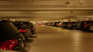 A really full underground parking garage with cars