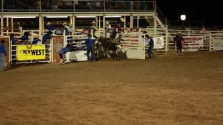 a rodeo bull rider in slow motion