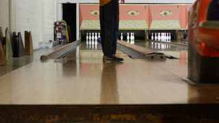 A shot of boys bowling at a bowling alley