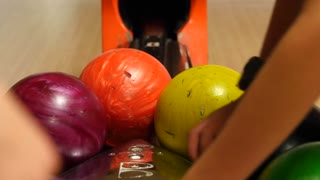 A shot of people getting their bowling balls