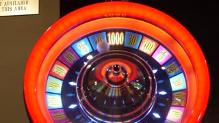 A slot machine and bright lights in casino