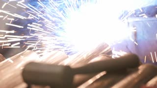 A Slow Motion Shot Of A Welder Working In The Machine Shop