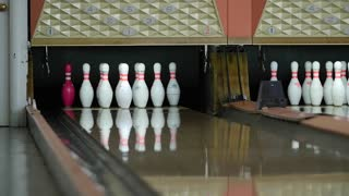A slow motion shot of ball hitting bowling pins