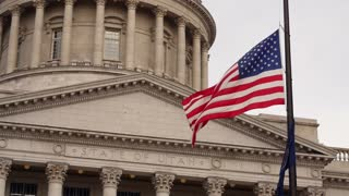A slow motion shot of flags at the Utah State Capitol Building