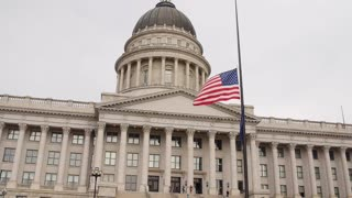 A slow motion shot of flags at Utah State Capitol Building