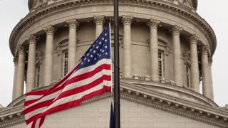 A static shot of Flag at Utah State Capitol Building