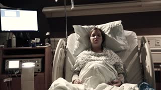 a woman during labor and delivery in hospital bed dolly