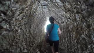 A woman in ancient Mayan tunnel at Coba
