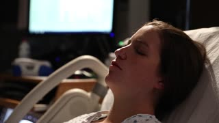 a woman in labor having contractions