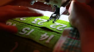 a woman using a sewing machine to make advent calendar