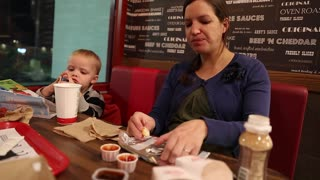 a young family eating fast food at a restaurant
