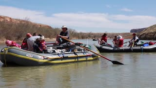a young family river rafting on san juan river