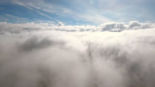 Aerial above the beautiful clouds in morning sun