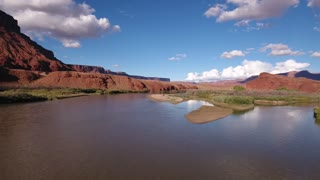 Aerial dolly shot above the colorado river in the desert