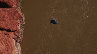 Aerial High Shot Of A Boat On Calm Desert River In Utah