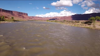Aerial low shot above the colorado river in desert
