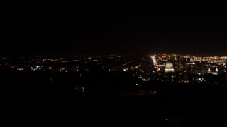 Aerial panning shot of downtown Salt Lake City Utah at night