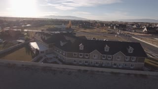 Aerial Rotating Shot Of Retirement Home By The Mountains In City