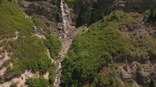 Aerial shot of a beautiful mountain waterfall