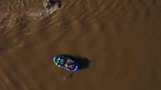 Aerial Shot Of A Boat On A Calm Desert River In Utah
