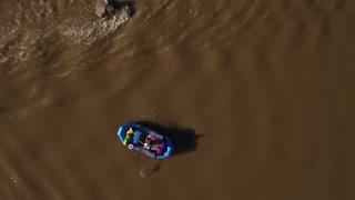 Aerial Shot Of A Boat On A Calm Desert River In Utah