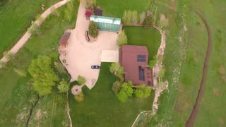 Aerial shot of a large home with solar panels on the roof