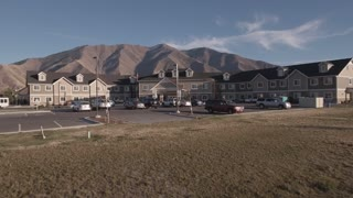 Aerial Shot Of A Nursing Home By The Mountains