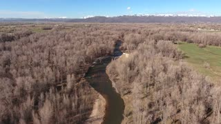 Aerial shot of beautiful river and nature preserve