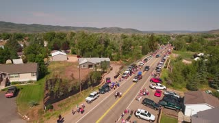 Aerial shot of people watching the small town parade in Utah