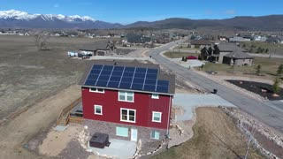 Aerial shot of solar panels on a house rooftop