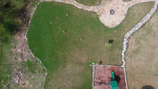 Aerial timelapse view of man mowing the lawn