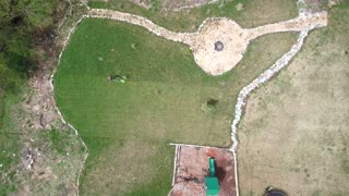 Aerial view of a man mowing the lawn