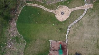 Aerial view of man mowing the lawn