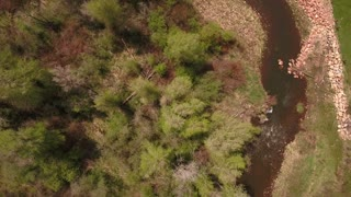 Amazing aerial shot above river in green springtime