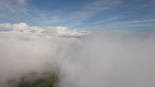 An aerial above beautiful clouds in the morning sun